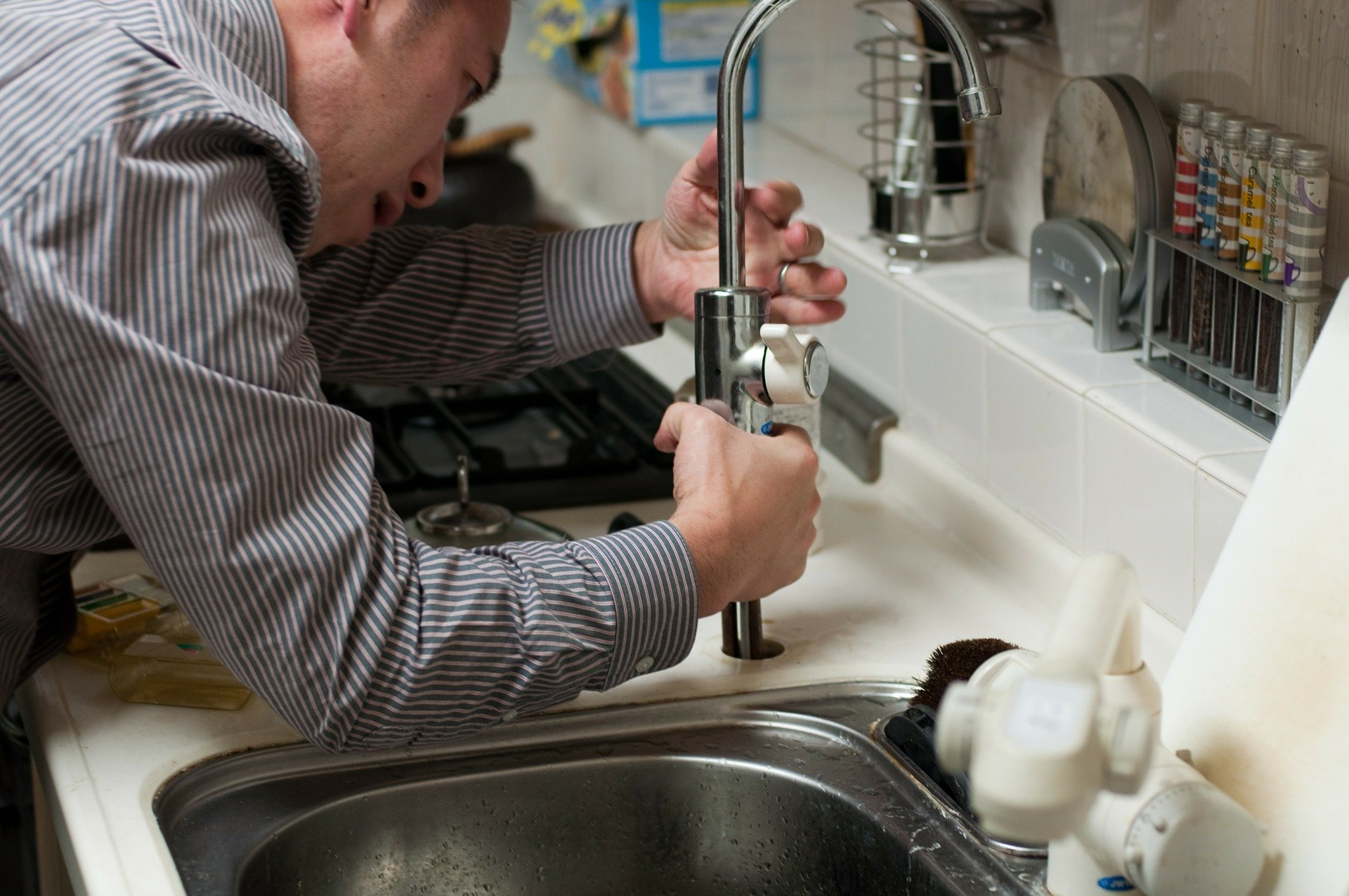 plumbing assisting resident with water leak